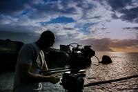 Cameraman preparing his camera
