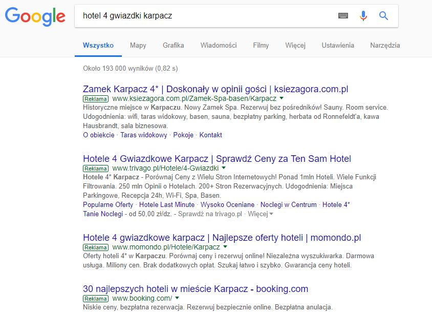 """Linki z płatnych kampanii AdWords wyświetlają się nad naturalnymi wynikami wyszukiwania, są także oznaczone jako """"Reklama""""."""
